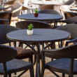 Street cafe with dark furniture — Stock Photo