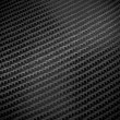 Black carbon fibre background — Stock Photo