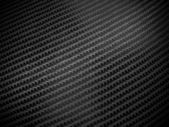 Black carbon fibre background — Стоковое фото