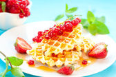 Waffles with berries — Stock Photo