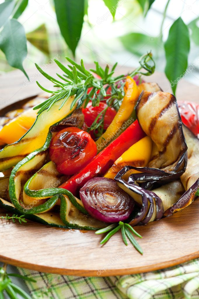 Grilled vegetables with rosemary and thyme on the wooden plate — Stock Photo #11104833