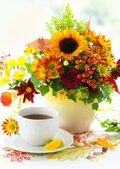Fall still life with cup of tea — Stock Photo