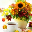 Royalty-Free Stock Photo: Cup of tea and autumnal flowers