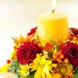 Wreath of autumn flowers and candle — Stock Photo