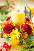 Wreath of autumn flowers and candle — Photo