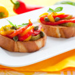 Bruschetta with bell pepper salad — Photo