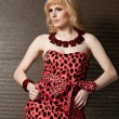Strict girl blonde in leopard dress — Stock Photo
