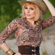 Cute blonde girl in a cowboy hat — Stock Photo