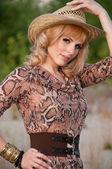 Cute blonde girl in a cowboy hat — Стоковое фото