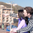Royalty-Free Stock Photo: The guy shows the girl sights