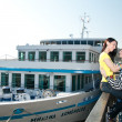 图库照片: Lovers nice talk on dock against ships