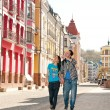 Stock Photo: Boy and girl tourists strolling through beautiful streets of