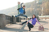 A guy in a jump near his girl — Stock Photo