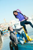 The boy recognized the girl in love at the pier — Stock Photo