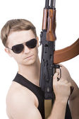 Power man with rifle — Stock Photo
