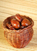 Dates in the bamboo jar — Stock Photo