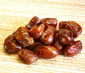 Sweet bright dates on wicker natural background — Stock Photo