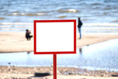 Sign on the shore — Stock Photo