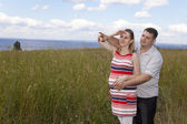 Husband and a pregnant wife in nature — Stock Photo