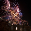 Fireworks over amphitheater — Stock Photo