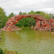 A stone cliff in the park of Disneyland. Paris - Stock Photo