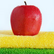 Red apple on towels — ストック写真