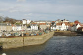 Harbour boats and town of Pittenweem — Stock Photo