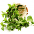 Mint leaves in a basket - Stock Photo