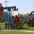 An oil pump jack — Stock Photo #10807196
