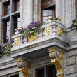 Stock Photo: Balcony with statue and flowers in Brussels