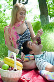 The young couple has a rest outdoors — Stock Photo