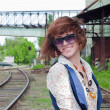 The young girl in railway park — Stockfoto