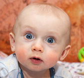 Curious Baby making surprised face — Stock Photo