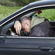 Stock Photo: Drunk man asleep at the wheel