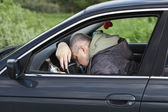 Drunk man asleep at the wheel — 图库照片