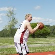 Stock Photo: Basketball player with the ball