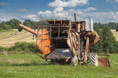Old harvester near the field — Stock Photo
