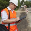 Engineer near the road repair work — Stock Photo