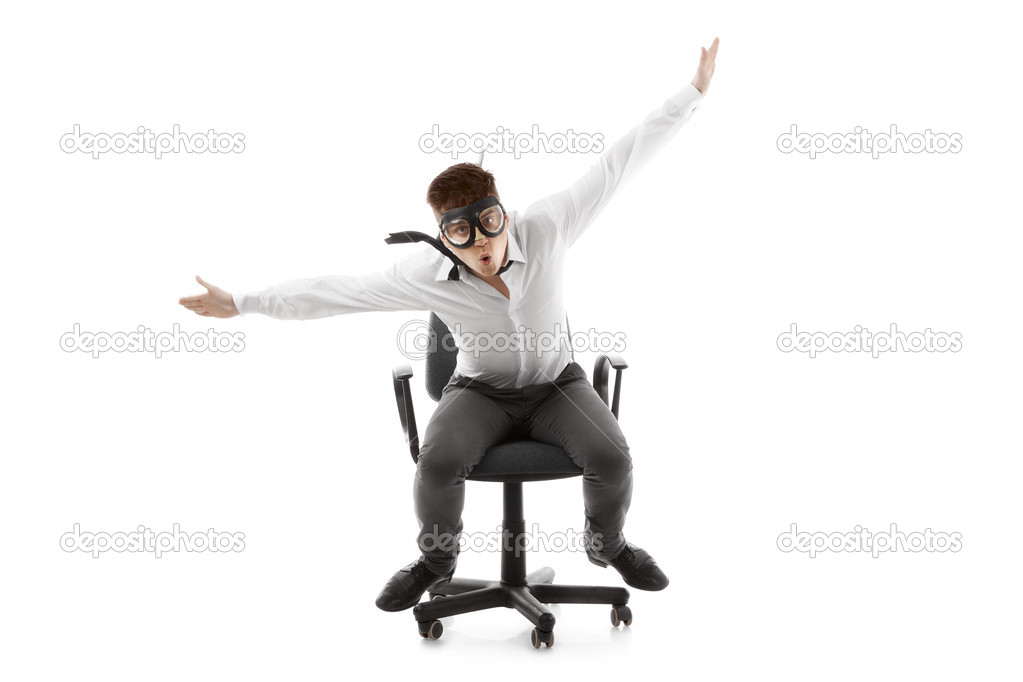 Image of a funny young man on chair  Foto de Stock   #11329394
