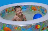 Smiling boy in the pool — Stock Photo