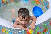 Boy in pool — Stock fotografie