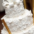 A white wedding cake - Stock Photo