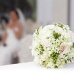 Wedding bouquet in basket — Stock Photo