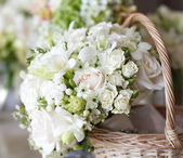 Wedding bouquet in basket — Stock Photo