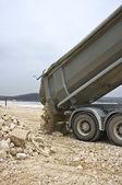 Dump truck unloading — Stockfoto