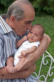 Senior Man Holding His Great-grandson — Stock Photo