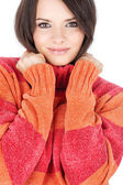 Cute brunette in a red-orange wool sweater — Stock Photo