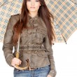 Pretty woman under umbrella - Stock Photo