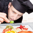 Chef decorating delicious fruit plate — Stock Photo #11270419
