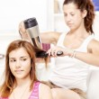 Teenage girl dries hair to her friends — Stock Photo #11694713